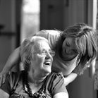 care worker talking to an individual  who needs care and support in a wheelchair