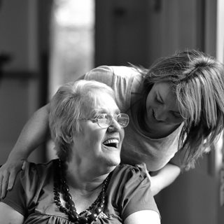 care worker talking to an individual who needs care and support