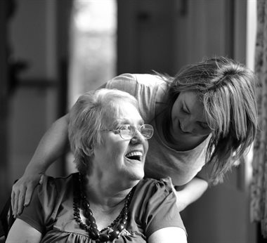 Care worker speaking to an individual who needs care and support