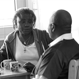 Care worker talking to individual who needs care and support
