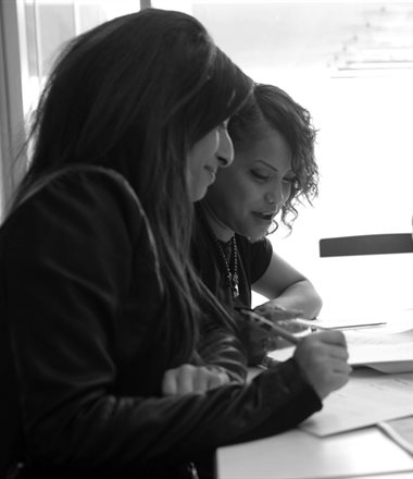 Two apprentices at a desk working