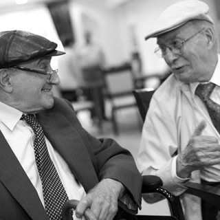 Two older men chatting